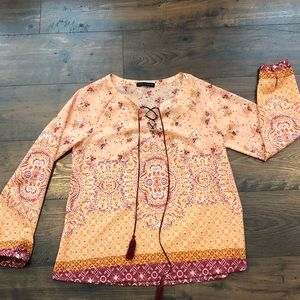 Beautiful patterned tunic with silky tasseled ties